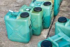 Réservoirs de carburant en plastique verts Photographie stock libre de droits
