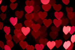 Résumé - lumières de coeur de tache floue - signe d'amour Photographie stock libre de droits