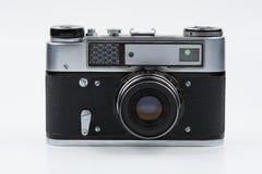 Rétro appareil-photo de film sur un fond blanc photographie stock libre de droits