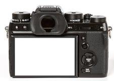 Rétro appareil photo numérique mirrorless moderne du dos, d'isolement sur Wh image libre de droits