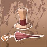Rétro chapeau et parapluie sur un fond de Brown Image libre de droits
