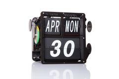 Rétro date de calendrier mécanique d'isolement Photographie stock