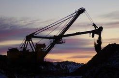 Rétro excavatrice dans l'action photos libres de droits