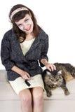 Rétro fille avec un chat Images stock