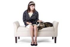 Rétro fille avec un chat Photographie stock
