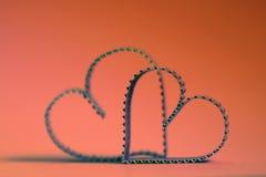 Rétro heureux des textes de forme de coeur Photographie stock