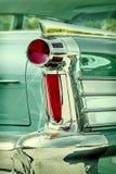 Rétro image dénommée du dos d'une voiture classique verte Photos libres de droits