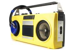 Rétro jaune de sableuse de ghetto avec des écouteurs photos libres de droits