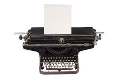 Rétro machine à écrire avec avec une page de papier blanche d'isolement sur le fond blanc Photos libres de droits
