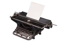 Rétro machine à écrire avec avec une page de papier blanche d'isolement sur le fond blanc Photo libre de droits