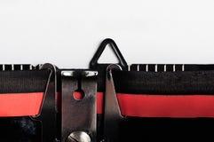 Rétro machine à écrire avec la fin de papier blanc  Images stock