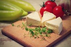 Rétro photo de vintage de trois parties de camembert Image stock