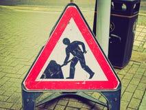 Rétro signe de travaux routiers de regard Images libres de droits