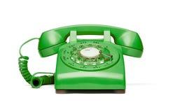 Rétro téléphone vert sur le fond blanc. Photo stock