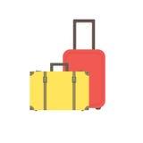 Rétro valise jaune avec des boucles et des courroies et une valise rouge moderne sur des roues Images stock