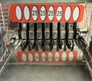 Rétros 25 fentes de pièce de monnaie de cent Photographie stock