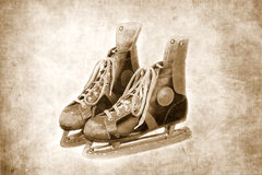 Rétros patins de glace sur le fond grunge Photographie stock