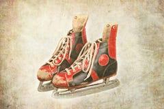 Rétros patins de glace sur le fond texturisé Image libre de droits