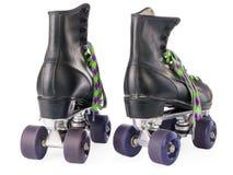 Rétros patins de rouleau d'isolement image libre de droits