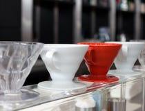 Rétros tasses de café dénommées dans une rangée Photographie stock