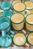 Rétros tasses de l'eau de zinc de style Photos stock