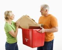 Réutilisation d'homme et de femme. Images stock