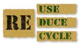 Réutilisez - les mots de Réutilisation-réutilisation sur le papier Photos libres de droits