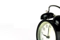 Réveil sur le blanc, montrant l'horloge de ` de neuf o photographie stock libre de droits
