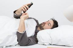 Réveillé par le téléphone photos libres de droits