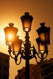 Réverbère de cru au coucher du soleil Photos libres de droits