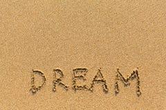 Rêve - dessiné de la main sur le sable de plage Photo stock