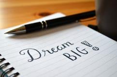 ` Rêveur de ` grand main-en lettres dans le carnet Photo stock