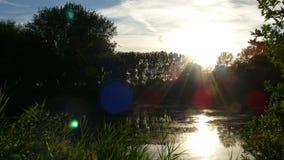 Río de la puesta del sol Imagenes de archivo