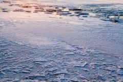 Río del invierno en la puesta del sol Foto de archivo libre de regalías