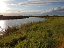Río del verano de la puesta del sol Imagen de archivo libre de regalías
