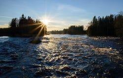 Río en puesta del sol Foto de archivo libre de regalías