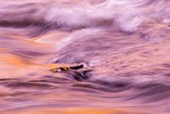 Río turbulento en la puesta del sol Imagen de archivo libre de regalías