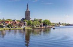Río y torre de la iglesia de Stephanus en Hasselt Imágenes de archivo libres de regalías