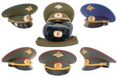 Różne rosyjskie dowóca wojskowy nakrętki nad bielem obraz royalty free