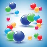 Różnego colour szklane piłki na błękitnym tle ilustracji