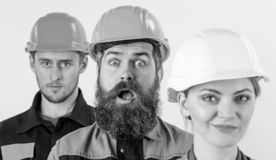 Różni ludzie w drużynie architekci, budowniczowie, robotnicy, zdjęcia stock