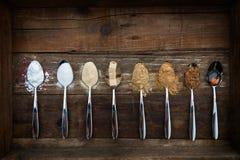 Różni rodzaje cukier w łyżkach Fotografia Stock