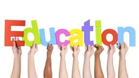 Różnorodne ręki Trzyma słowo edukację Zdjęcia Stock