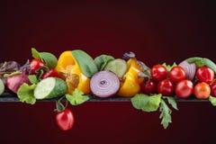 Różnorodni świezi lat wegetables na zmroku - czerwony tło Zdjęcia Royalty Free