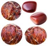 Różnorodni czerwoni sunstone kaboszony, goldstones i Fotografia Royalty Free