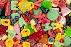 Różnorodni kolorowi cukierki obraz stock