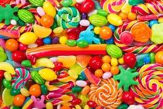 Różnorodni kolorowi cukierki, galarety, lizaki i marmoladowy, obrazy stock