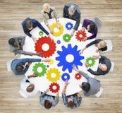 Różnorodni ludzie biznesu z przekładnia symbolem Zdjęcia Stock