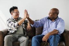 Różnorodni mężczyzna łączy ręki wpólnie Obraz Stock