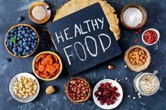 Różnorodni super foods w pucharach na stole Zdrowy jedzenie, zdrowy utrzymanie fotografia royalty free